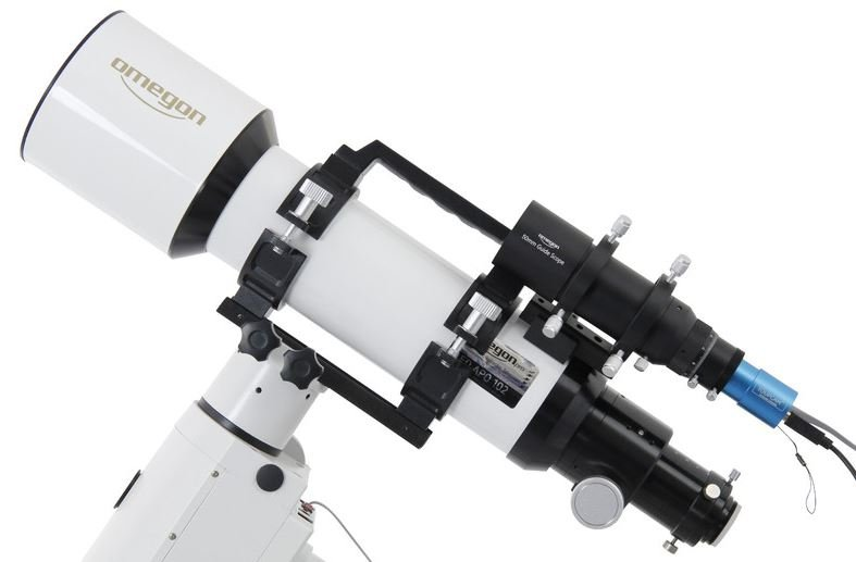 The image shows a guidescope mounted parallel to the telescope. The blue camera is aligned with a guide star. It sends control pulses to the mount via a connected computer.
